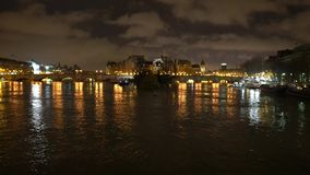 View of the Saine river, Cite island and Pont Neuf from Pont des Arts before sunrise. Paris,France-January 26, 2018:View of the Saine river, Cite island and Pont stock video footage