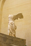 PARIS, FRANCE , JANUARY 26, 2017: Winged Victory of Samothrace, called Nike of Samothrace, hellenistic marble sculpture Stock Image