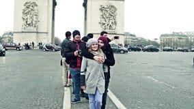 PARIS, FRANCE - JANUARY, 1, 2017. Young couple posing near famous triumphal arch, Arc de Triomphe. 4K clip. PARIS, FRANCE - JANUARY, 1, 2017. Young couple posing stock footage
