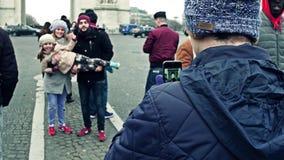 PARIS, FRANCE - JANUARY, 1, 2017. Young family posing near famous triumphal arch, Arc de Triomphe. 4K video. PARIS, FRANCE - JANUARY, 1, 2017. Young family stock video footage