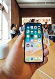 Man holding iPhone X smartphone in Apple Store royalty free stock image