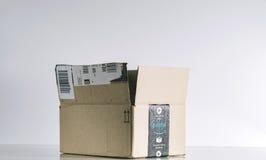 Amazon box in studio background. PARIS, FRANCE - JUL 30, 2017: Open Amazon Prime cardboard box side. Amazon is an American electronic e-commerce company stock photography