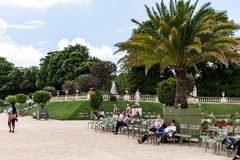 Tourists and Parisians relaxing in the Luxembourg Gardens. Paris Stock Images