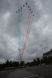 Paris, France - July 14, 2012. Alpha jets from Patrouille de France fly over the Champs Elysees . Royalty Free Stock Images