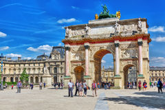 PARIS, FRANCE - JULY 06, 2016 : Arc de Triomphe du Carrousel (18. 06-1808) and people around, designed by Charles Percier near Louvre, Paris, France Stock Photo