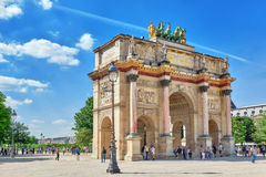 PARIS, FRANCE - JULY 06, 2016 : Arc de Triomphe du Carrousel (18. 06-1808) and people around, designed by Charles Percier near Louvre, Paris, France Royalty Free Stock Image