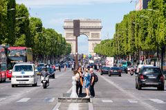 The Avenue des Champs Elysees on a beautiful summer day in Paris Royalty Free Stock Images
