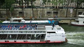 Cruise on river Seine. Paris, France - July 1, 2017: Bateaux-Mouches with many tourist during a trip on the Seine river, under Pont Saint Michel. Cathedral of stock video