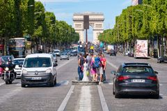 The Champs-Elysees with the Arc de Triomphe in central Paris. PARIS,FRANCE - JULY 29,2017 : The Champs-Elysees with the Arc de Triomphe in central Paris on the Stock Photos