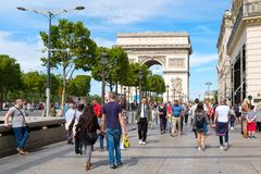 The Champs-Elysees and the Arc de Triomphe in Paris on a  summer. PARIS,FRANCE - JULY 29,2017 : The Champs-Elysees and the Arc de Triomphe in central Paris on a Stock Photography