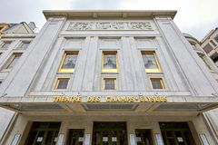 Champs Elysees theater facade with golden sign in summer in Paris, France. PARIS, FRANCE - JULY 22, 2017: Champs Elysees theater facade with golden sign in stock photo