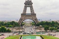 Paris, France July 24, 2017: Eiffel Tower close-up of a road with cars and buses traffic from a transporter, passage under an arch. A square for tourists. A Stock Photos