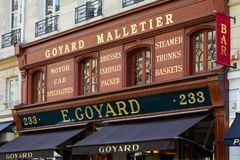 Goyard luxury shop in Paris with wooden facade and golden letters sign in summer. PARIS, FRANCE - JULY 07, 2018: Goyard luxury shop in Paris with wooden facade royalty free stock photo