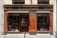 Goyard luxury store in Paris with windows and wooden facade in a sunny day stock photos