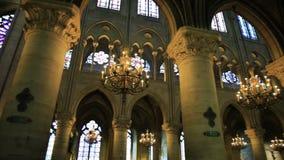 Notre Dame colonnade. PARIS, FRANCE - JULY 2, 2017: interior colonnade panorama of Notre Dame Gothic cathedral walking of left side nave. Candelabrum ceiling stock video footage