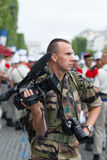Paris. France. July 14, 2012.Legionnaire photographer photographs parade on the Champs Elysees. Royalty Free Stock Photos