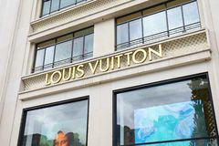 Louis Vuitton fashion luxury store in Champs Elysees in Paris, France. PARIS, FRANCE - JULY 22, 2017: Louis Vuitton fashion luxury store in Champs Elysees in royalty free stock photos