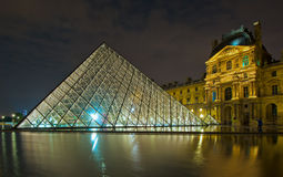 PARIS, FRANCE - July, 22, 2011: Louvre museum at night. The Louv Stock Photography