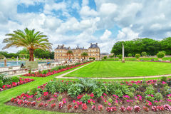 PARIS, FRANCE - JULY 05, 2016 : Luxembourg Palace and park in Pa. Ris with people, the Jardin du Luxembourg, one of the most beautiful gardens in Paris. France Stock Images