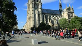 Tourism in Notre Dame. Paris, France - July 1, 2017: many tourists in square of Notre Dame de Paris, Ile de la Cite, while they wait to visit the famous gothic stock footage