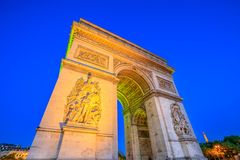 Arc de Triomphe night. Paris, France - July 2, 2017: Night view of Arch of Triumph at the center of the Place Charles de Gaulle. Bottom view of popular landmark Royalty Free Stock Photo