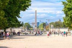 Parisians enjoying summer at the Tuileries Garden in Paris. PARIS,FRANCE - JULY 29,2017 : Parisians enjoying summer at the Tuileries Garden in Paris with a view Royalty Free Stock Photos