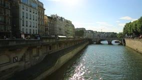 Pont Saint Michel bridge. Paris, France - July 1, 2017: Pont Saint Michel bridge over river Seine, historic Parisian building within Palais de Justice complex stock video footage