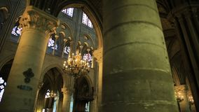 Notre Dame colonnade. PARIS, FRANCE - JULY 2, 2017: pov walking in interior colonnade of Our Lady of Paris church, Notre Dame Gothic cathedral in left side nave stock video footage