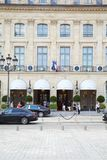 Ritz luxury hotel with people in place Vendome in Paris in a sunny day stock images