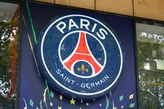 Paris Saint Germain football team store sign in Champs Elysees in Paris, France. PARIS, FRANCE - JULY 22, 2017: Paris Saint Germain football team store sign in stock photo