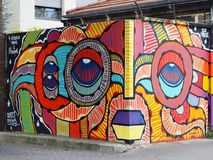 4 oiseaux dans 1 masque. PARIS, FRANCE - JULY 4, 2018: Street artist Da Cruz` graffiti `4 oiseaux dans 1 masque` - 4 birds in 1 mask- on July 4, 2018 in Paris stock images