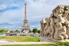Street scene in Paris with a view of  the Eiffel Tower. PARIS,FRANCE - JULY 30 : Street scene in Paris with a view of  the Eiffel Tower Royalty Free Stock Images