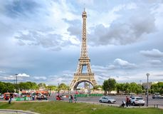Street scene in Paris with traffic next to the Eiffel Tower Stock Photos