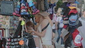 PARIS, FRANCE-JULY 23,2015: Tourists near the shop with souvenirs on july 23, 2015 in Paris, France stock video