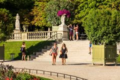 Tourists and Parisians relaxing in the Luxembourg Gardens. Paris. Paris, France - July 07, 2017: Tourists and Parisians relaxing in the Luxembourg Gardens Jardin Stock Photos