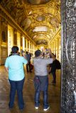 Paris, France - July 14, 2013: Tourists visit art gallery in the Louvre Museum. The Louvre Museum is one of the largest and most visited museums worldwide Stock Images