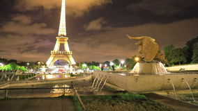 Trocadero bull statue. PARIS, FRANCE - JULY 2, 2017: Trocadero gardens bull statue at night with fountains and tourists. French capital of Europe with lit Eiffel stock footage