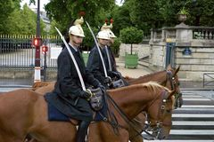 PARIS, FRANCE,  10 JULY,  2014- Troop of Mounted French Republican Guard. Close up of guard troops on horses with swords helmets Stock Photo