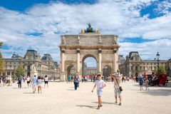 The Tuileries Garden and the Louvre Museum in Paris on a summer day. PARIS,FRANCE - JULY 29,2017 : The Tuileries Garden and the Louvre Museum in Paris on a Stock Photos