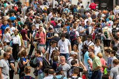 Crowd of visitors stock images