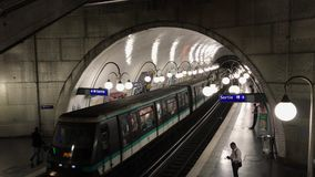 Trains on metro station in Paris. PARIS, FRANCE - JUNE 14, 207: Arriving and departing trains on metro station stock footage