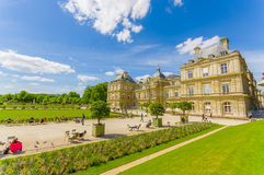 Paris, France June 1, 2015: Beautiful Luxemburg Palace with stunning sorroundings, large lake and garden environment Stock Image