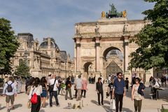Carrousel Arc de Triomphe, Louvre Museum and Pyramid. Paris, France - 24 June 2018: Carrousel Arc de Triomphe, Louvre Museum and Pyramid Stock Photo