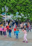 Paris, France, June 2019: Children enjoying bubbles show on the Place de l`Hotel de Ville royalty free stock images