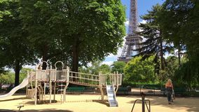Daytime timelapse of Eiffel Tower, Paris. PARIS, FRANCE - JUNE 2017: Children playing in the playground in the park with a view not the Eiffel Tower stock video