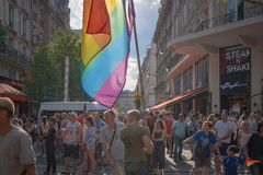 Crowd is looking at a float coming at the 2018 Paris Gay Pride royalty free stock photography