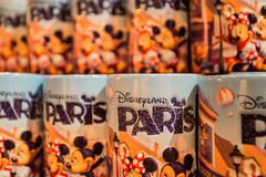 PARIS, FRANCE - JUNE 11, 2014: Disneyland souvenir mugs close. PARIS, FRANCE - JUNE 11, 2014: Close-up several Disneyland souvenir mugs with Mickey Mouse on them royalty free stock photography