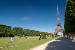 Eiffel Tower from the Champ de Mars gardens in summer. Royalty Free Stock Photography