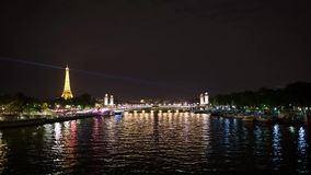 Eiffel Tower Timelapse Video over the Seine river. PARIS, FRANCE - JUNE 09, 2017: Eiffel Tower over Seine river night timelapse video stock video footage