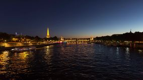 Eiffel Tower Timelapse Video over the Seine river. PARIS, FRANCE - JUNE 09, 2017: Eiffel Tower over Seine river timelapse video at dusk stock video